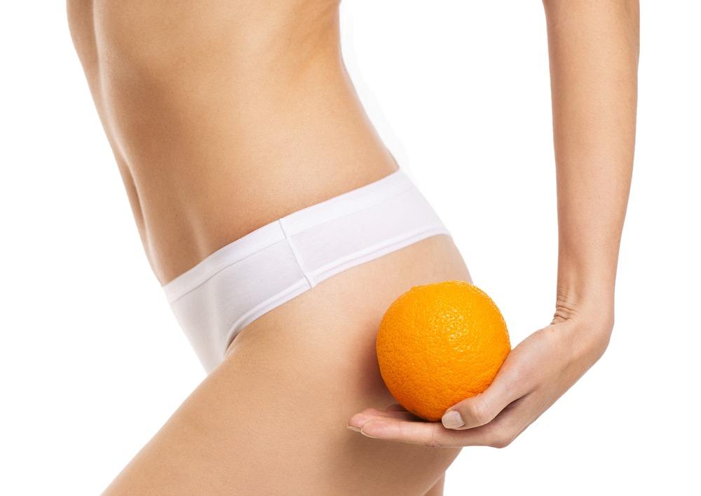 Beautiful,Slim,Female,Waist,On,A,White,Background,With,Orange